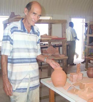 Name:  pottery12- Bell showing off MNI clay.jpg Views: 271 Size:  44.3 KB